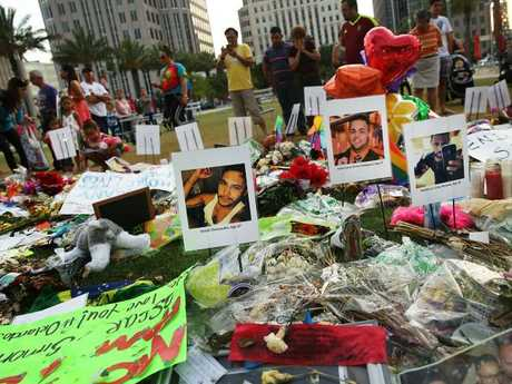 People visit a memorial for those killed at the Pulse nightclub. Picture: Getty Images