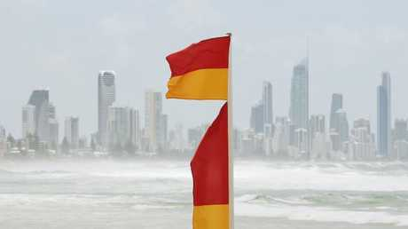 A red and yellow flag with the Gold Coast skyline behind it. Picture: Brendan Radke.
