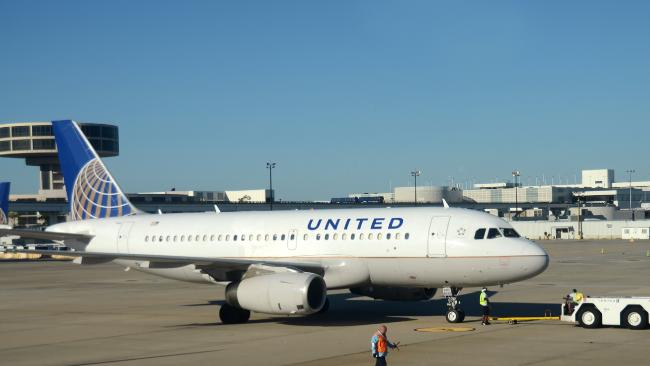 A United aircraft has been diverted after a passenger smeared faeces in the bathroom.