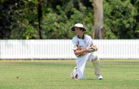 BITS wicket keeper Bill Dwan in the cricket game against Brothers in Rockhampton.