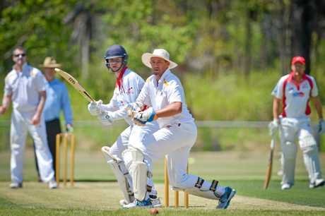 Zane Robinson strokes one to the leg side as wicketkeeper Eric Fourie watches on.