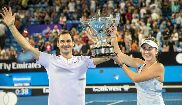 Roger Federer and Belinda Bencic of Switzerland celebrate their finals win at the Hopman Cup.