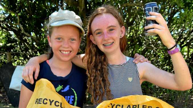Jessica Hobbs,11 and Tallulah Veal-Sinclair, 13, with bags of rubbish. Tallulah organised the clean up event to help keep the ocean and wildlife healthy.