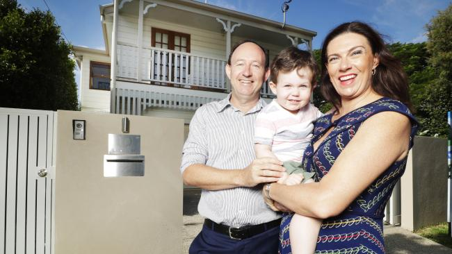 Samantha and Malcolm Hall, with their son Max, outside their recently sold replica Queenslander in Hawthorne. Photo: Lachie Millard.