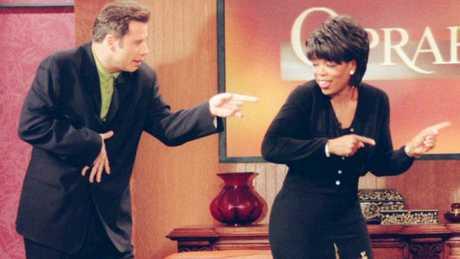John Travolta gives Oprah Winfrey a dance lesson on The Oprah Winfrey Show.