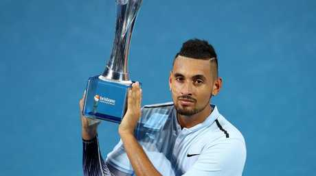 Nick Kyrgios of Australia holds the winners trophy after the Men's Final match against Ryan Harrison