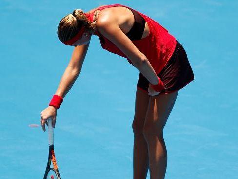 Kristina Mladenovic succumbs to the heat at the Sydney International.