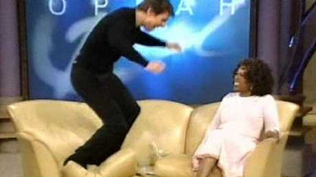Tom Cruise jumps on the couch after proclaiming his love for actor Katie Holmes.