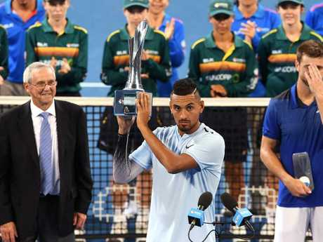 Nick Kyrgios of Australia holds the winners trophy after defeating Ryan Harrison