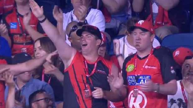 A Melbourne Renegades fan appears to make a white power salute after a Cameron White four against the Stars.