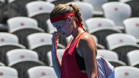 Kristina Mladenovic walks from the court after retiring early from her match against Ellen Perez.