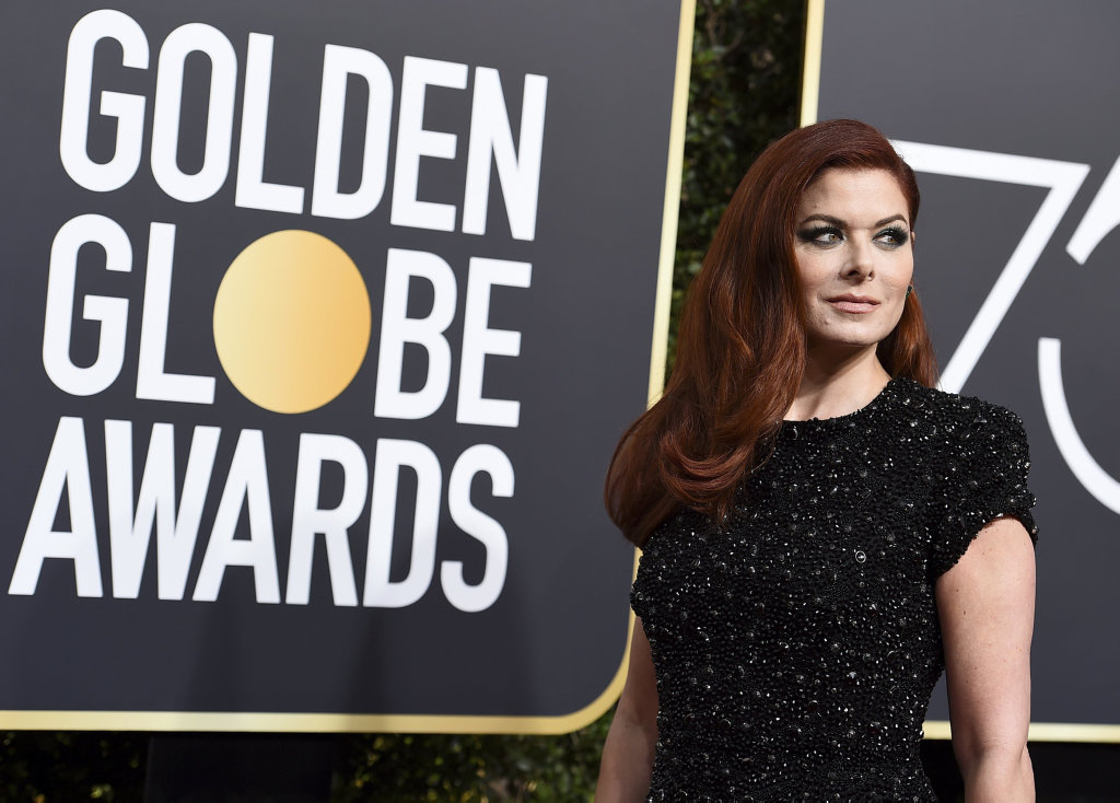Debra Messing arrives at the 75th annual Golden Globe Awards at the Beverly Hilton Hotel in Beverly Hills, Calif.