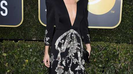 Margot Robbie arrives at the 75th annual Golden Globe Awards at the Beverly Hilton Hotel in Beverly Hills, Calif.