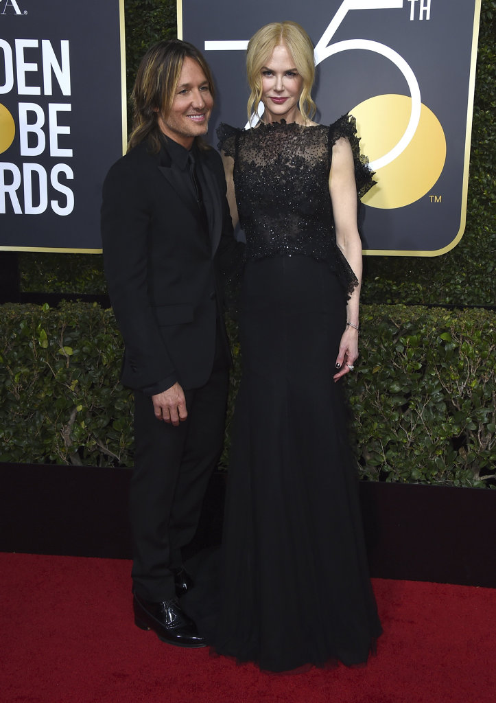 Keith Urban, left, and Nicole Kidman arrive at the 75th annual Golden Globe Awards at the Beverly Hilton Hotel in Beverly Hills, Calif.
