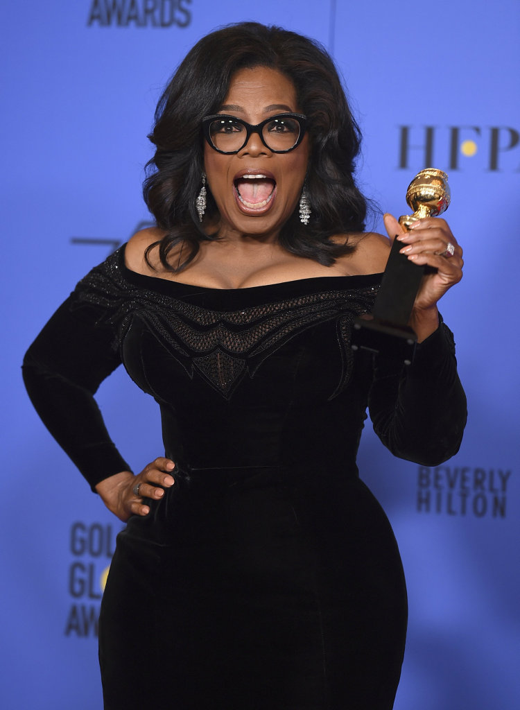 Oprah Winfrey poses in the press room with the Cecil B. DeMille Award at the 75th annual Golden Globe Awards at the Beverly Hilton Hotel in Beverly Hills, Calif.
