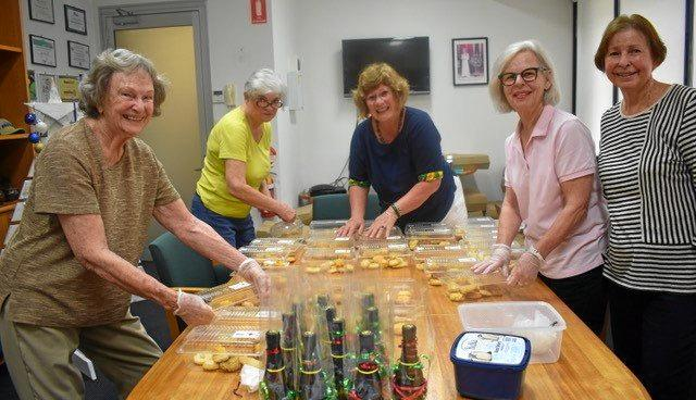 HELPING OTHERS: Western Suburbs Red Cross members Faye Morley, Lynne Cray, Annie Hall, Chris Hart and Merle Beresford packing the Biscuit Boxes.