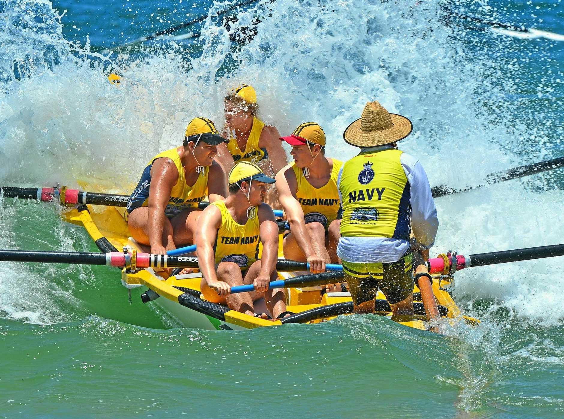 Alexandra Headland U19 surfboat crew competing in the first round of the Queensland Cup at Alexandra Headland on the Sunshine Coast.