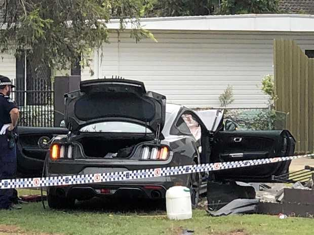 A stolen Ford GT Mustang was crashed through the front fence of a home in Archibald Street on Friday morning.