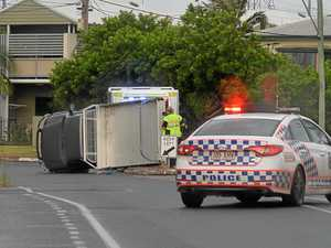 Vehicle rolls in wet weather at Mackay intersection