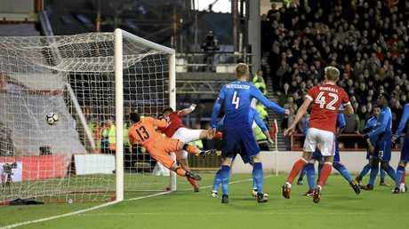 Eric Lichaj scores the opening goal for Nottingham Forest against Arsenal.