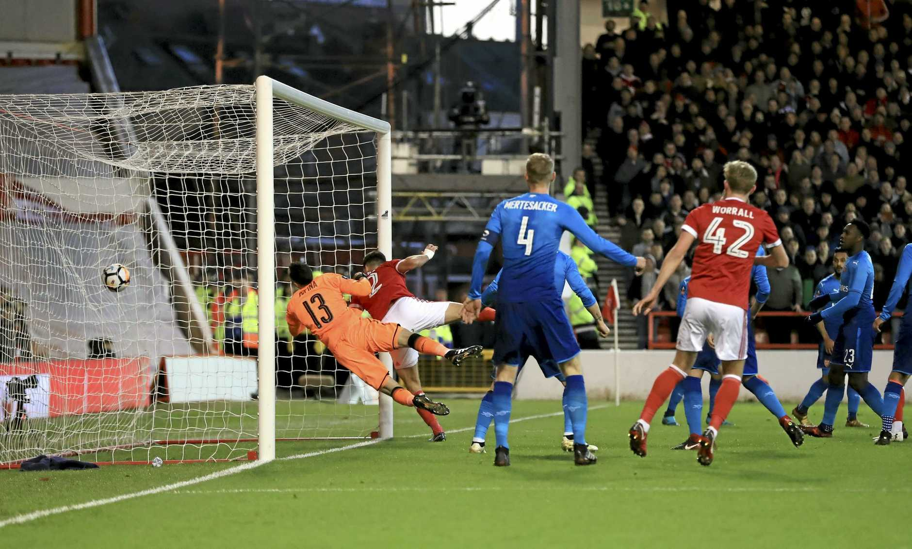 Eric Lichaj scores the opening goal for Nottingham Forest against Arsenal.