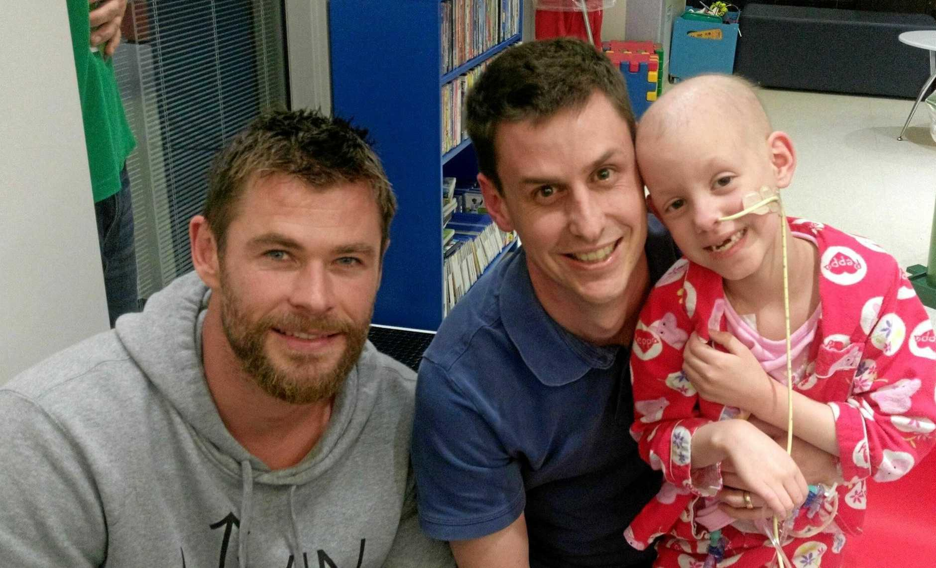 STAR VISIT: Hollywood heartthrob Chris Hemsworth visits Craig Box and his daughter Violet Box at Lady Cilento Children's Hospital in Brisbane during the filming of Thor Ragnarok in 2016.