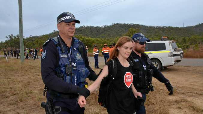 COAL FIGHT: Police arrest a protester at the anti-Adani protest on the Abbot Point access road.