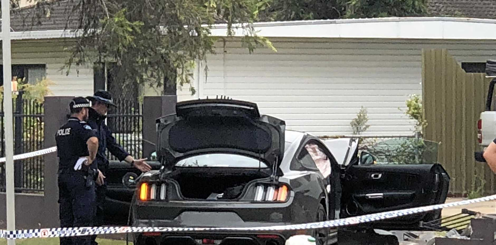 A stolen Ford GT Mustang was crashed through the front fence of a home in Archibald Street on Friday, January 5.