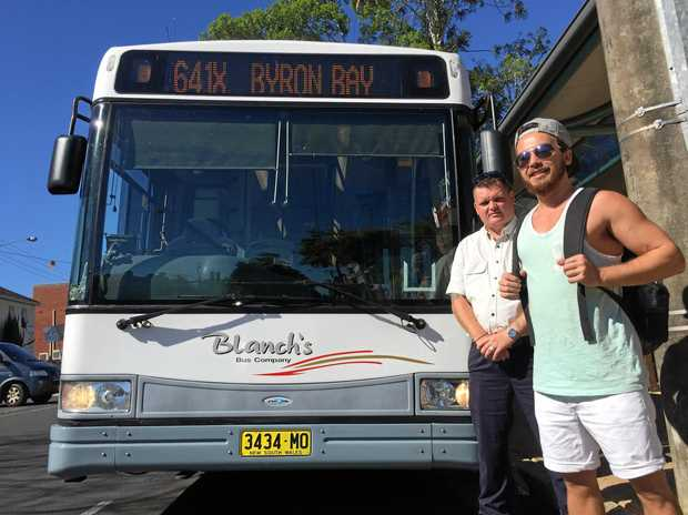 641X Blanch's bus driver, Jeffrey Moy, with passenger, Jonathan Dikih, getting on the express bus from Lismore to Byron Bay.