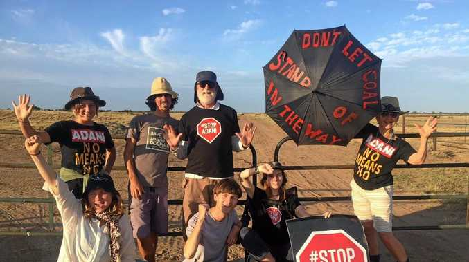 Front Line Action on Coal (FLAC) posted images of an Anti-Adani protest, captioned in part: Twenty people are blocking the access to the site of Adani's railway construction this morning, including three people, Kaiya, Bec and Ellie, who have locked on to the gates to stop work.