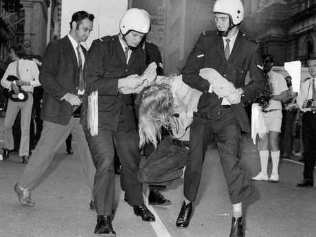 Police arrest a Queen Street demonstrator May 12, 1972.