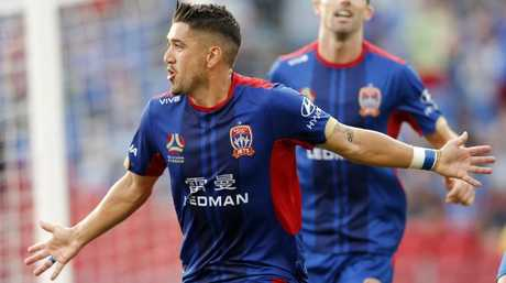 Dimitri Petratos of the Jets celebrates. (AAP Image/Darren Pateman)