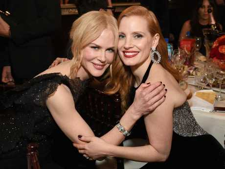 Nicole Kidman cuddles up to  Jessica Chastain at the 75th Annual Golden Globe Awards.