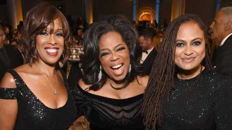 The ultimate powerhouse table — TV personality Gayle King, Oprah Winfrey and director Ava DuVernay.
