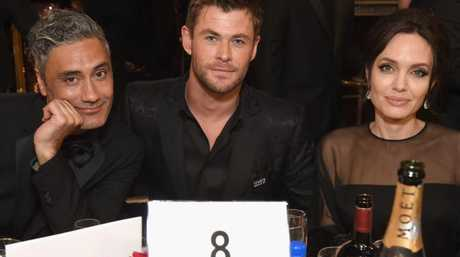 Chris Hemsworth and  Angelina Jolie  were seated next to Director Taika Waititi.