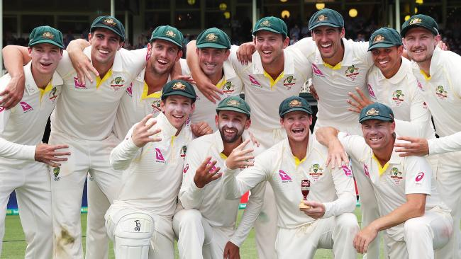 Australian captain Steve Smith and his team with the urn after defeating England at the SCG. Picture. Phil Hillyard