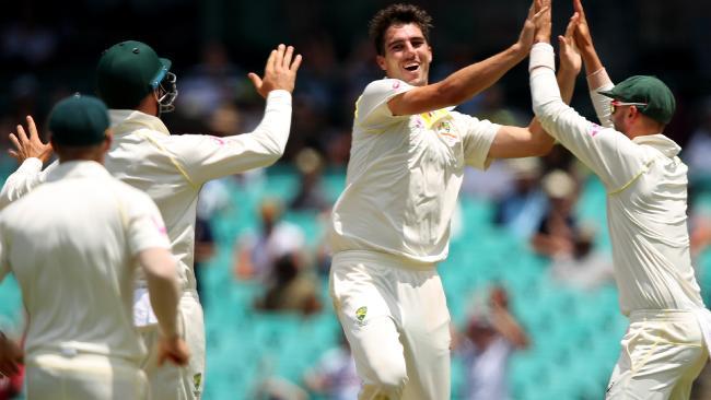 Australian players celebrate after Pat Cummins takes the wicket of England's Mason Crane on Monday.