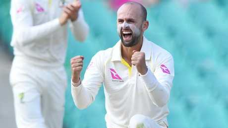Nathan Lyon celebrates a wicket.