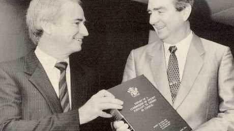 Tony Fitzgerald QC, with then-premier Mike Ahern, handing down the report of the Commission of Inquiry.