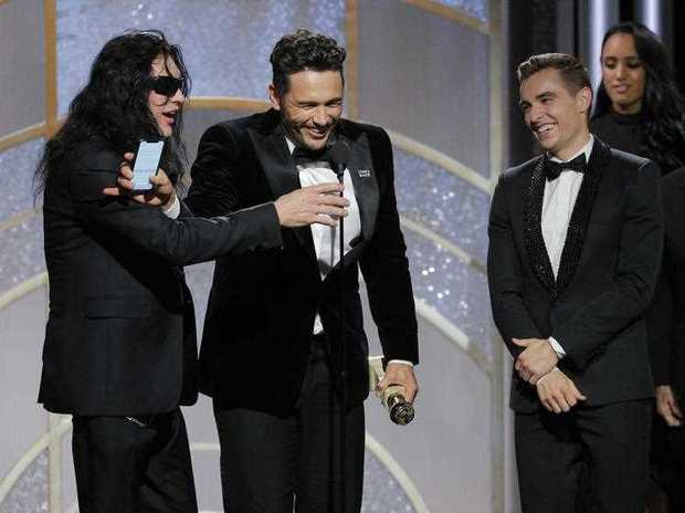 James Franco, center, accepting the award for best actor in a motion picture comedy or musical for his role in