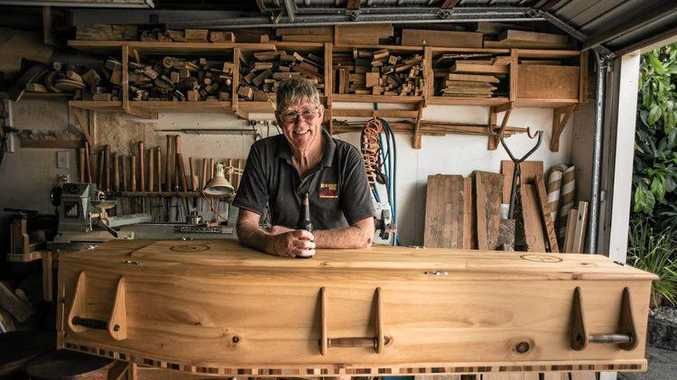 QUIRKY COFFINS: Coffin Club Rotorua member Dave, with one of his