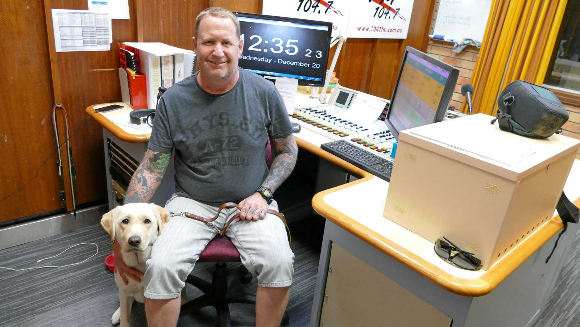 WORKING DOG: Radio 104.7FM disc jockey Phil Kennedy with his new guide dog Wanda in the studio.