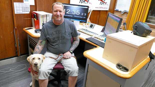 WORKING DOG: Radio 104.7FM disc jockey Phil Kennedy with his new guide dog Wanda in the studio.