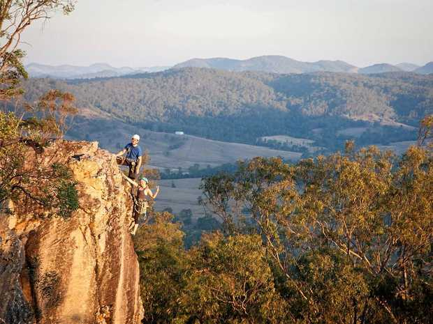 GRIPPING: Bruno Gohier and Olga Kuznetsova stand on the edge at the top of their climb at Brooyar State Forest, near Gympie. Photo: Andriy Doroshchuk