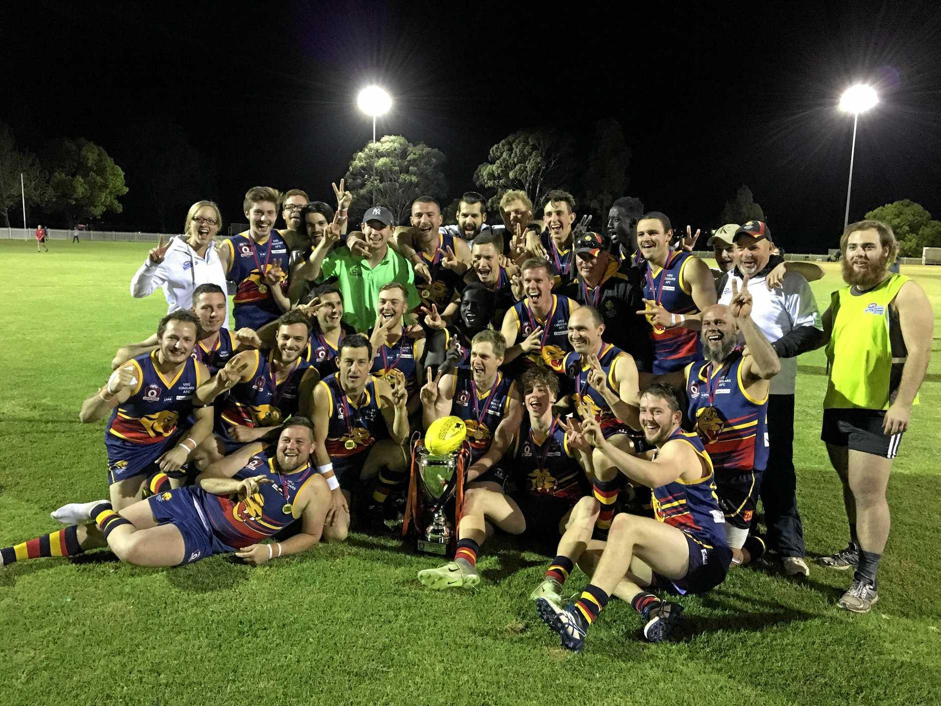 University celebrates winning the AFL Darling Downs grand final final over Goondiwindi at Rockville Park. Saturday, September 9, 2017