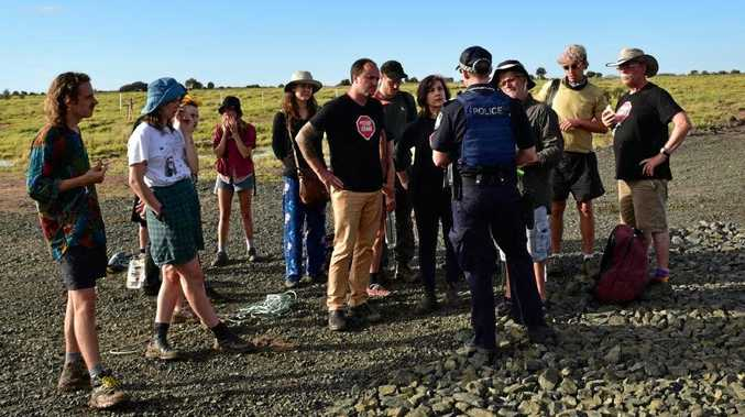 NSW Greens MPs Jeremy Buckingham and Dawn Walker were arrested by Queensland police after taking part in a blockade of the Adani Carmichael coal mine rail construction site at Belyando, 270km west of Bowen.