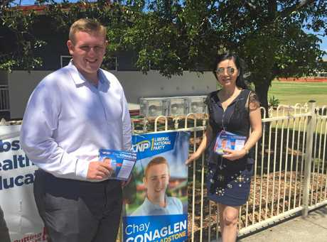FIGHTING TO THE END: Chay Conaglen with an LNP volunteer at Gladstone Central State School.