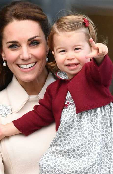 The Duchess of Cambridge likes to dress Princess Charlotte in burgundy. Picture: Mark Large/Daily Mail/PA Wire.