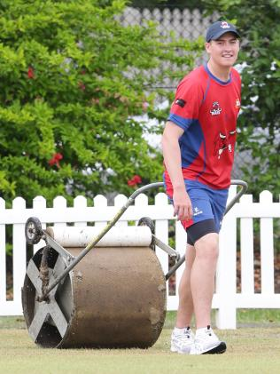Renshaw helping out on the field at Toombul. Photo: AAP/ Ric Frearson