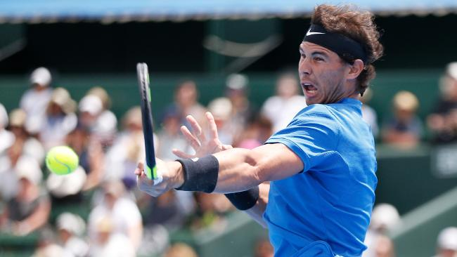 Rafael Nadal fires one back at Richard Gasquet during their clash at the Kooyong Classic. Picture: Getty Images